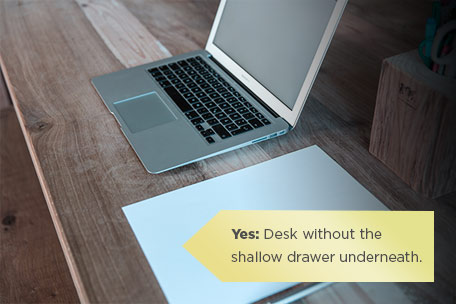 This desk has no drawer underneath - you can get good keyboard/wrist alignment.