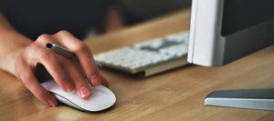 women in web development desk with keyboard